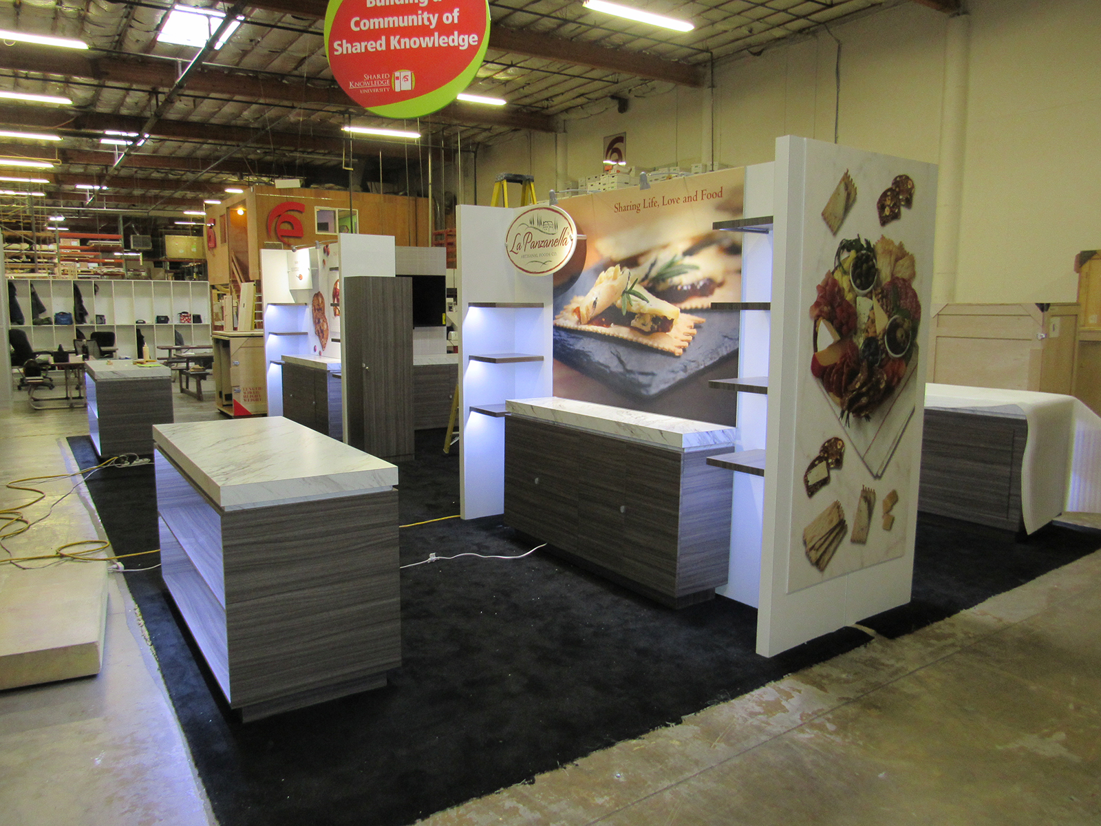 (4) Custom 10 x 10 Exhibits for a 20 x 40 Booth Space with Shelves, Product Counters, Locking Storage, and LED Accent Lights