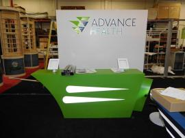 Custom Inline Exhibit with Backlighting, iPad Stands, and Charging Station Table