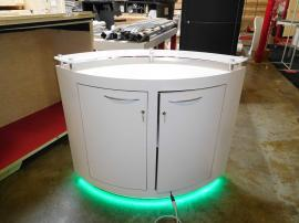 Custom Lens-shaped Counter with LED Lights and Locking Storage