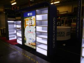 Custom Exhibit with LED Lit Shelving and Backlit SEG Fabric Lightbox
