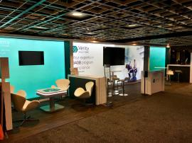 Custom Inline Exhibit with Large LED Lightboxes, Multiple Meeting Spaces, Monitor, Charging Station, and Storage