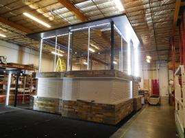 Custom 40 x 40 Island with Extensive Slatwall, Storage, LED Lightboxes, and Canopy Ceilings