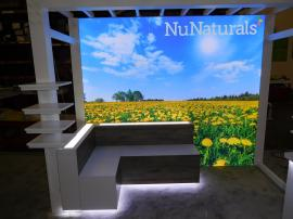 Custom Exhibit with Pergola, Product Shelves, Benches, LED Lightbox, Perimeter Accent Lights