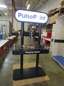 Custom Charging Station with Double-sided Backlit Graphics, Plex Counter Top, and Wireless and Wired Charging Options