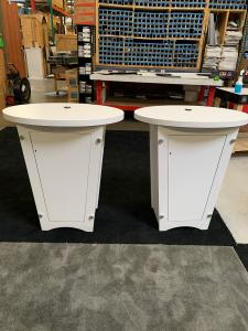 RENTAL: (2) RE-1201 Tapered Counters with White Laminated Finish, Locking Doors, and Interior Shelves. Includes Direct Print Sintra Graphics