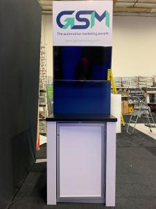 "RENTAL: RE-2086 Freestanding Lightbox, (2) Large Monitor Mounts, (2) 55"" Monitors, (2) Double-Sided Kiosks with (4) Monitor Mounts, (2) RE-1227 Workstation Counters, (4) 32"" Monitors, (1) 48"" Wide x 86"" High Double-Sided Lightbox, RE-1205 Large Curved Rec"