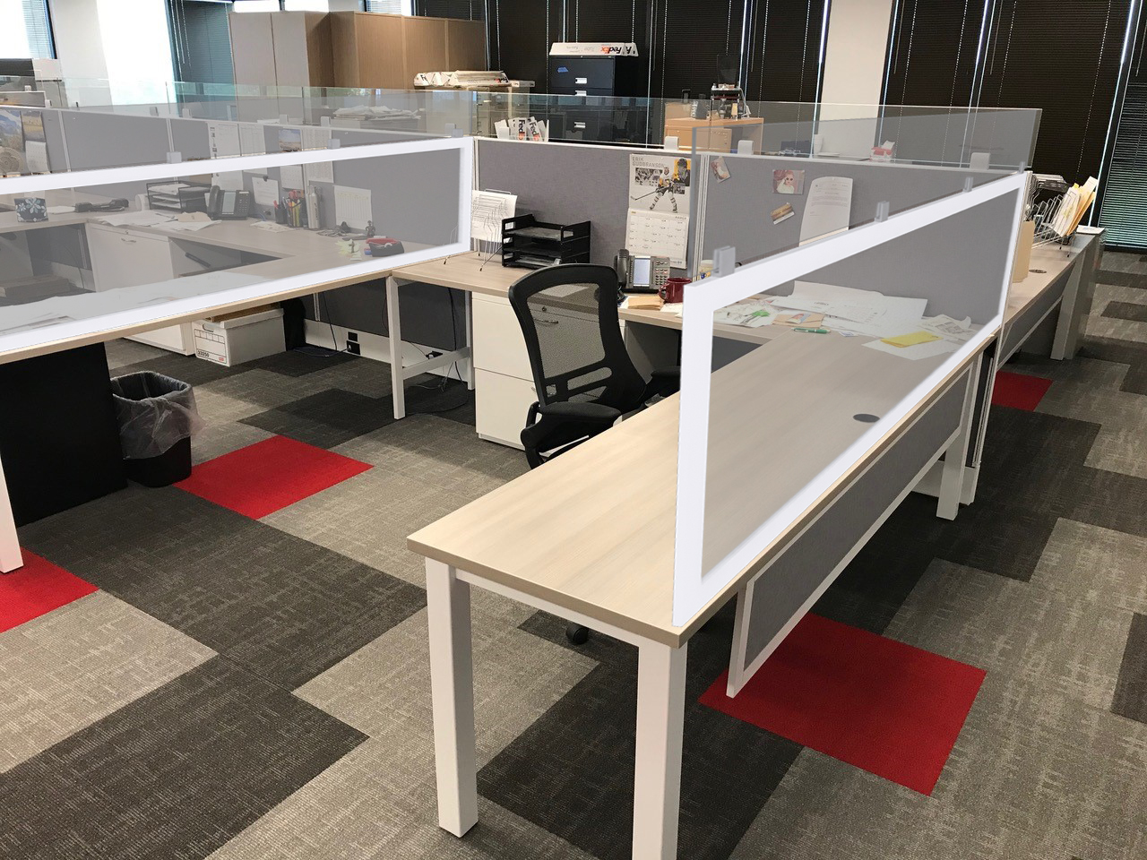 Office with plex dividers using existing desks and cubicles.